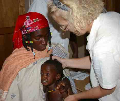Doctor diagnosing a child with malaria in cunene province angola