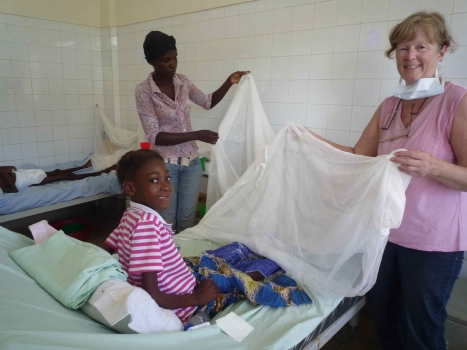 Happy to be receiving a mosquito net.
